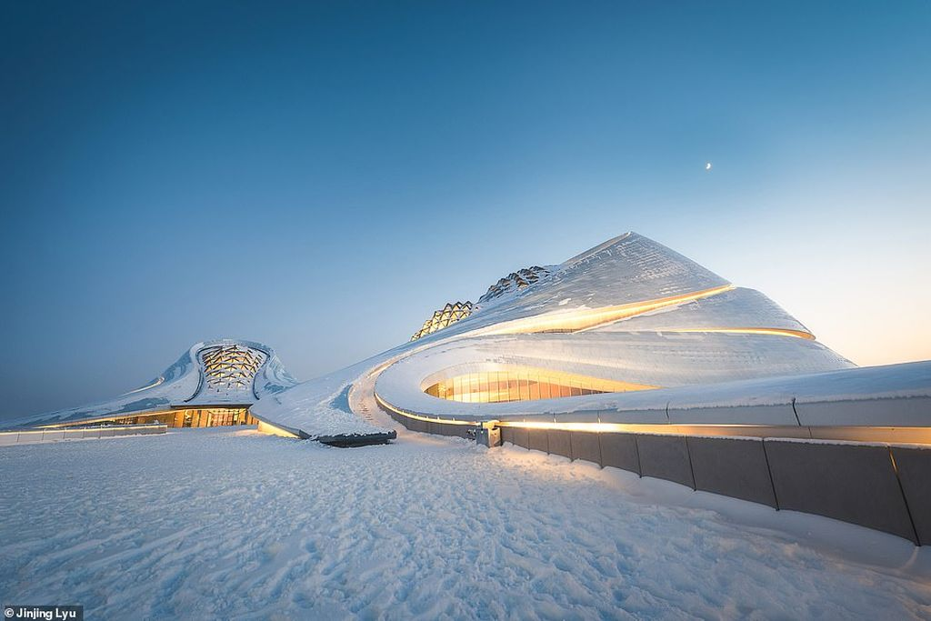 architecture photography snow covered harbin grand theatre by jinjing lyu